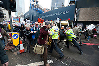 Angry students and electricians block Bishopsgate and scuffle with Police. 9-11-11 The protest was called by electricians complaining about a thirty percent paycut being brought in by the seven main construction companies.