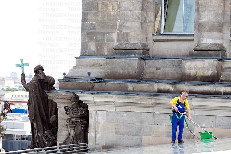 Worker cleaning the Reichstag roof, Berlin, Germany