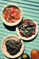 Hawaiian luau food: lomi salmon, poke and lau lau