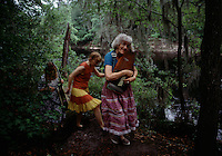 Musicians at the Florida Folklife Festival strum a dulcimer and stroll along the banks of the Suwannee River. <br />