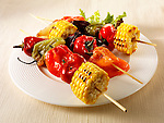 BBQ vegetarian kebabs of sweet corn, peppers &amp; red onions. Funky Stock Photos images.