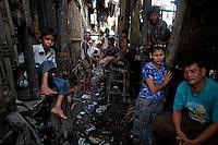 Myanmar Rohingya people pass the time at their slum near the sea in the town of Sittwe May 19, 2012. REUTERS/Damir Sagolj (MYANMAR)