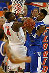 UK freshman forward Nerlens Noel grabs a rebound ball against UF junior center Patric Young during the second half of the University of Kentucky vs. University of Florida men's basketball game at the O'Connell Center in Gainesville, Fl., on Tuesday, February 12, 2013. UK lost 69-52. Photo by Tessa Lighty | Staff