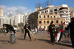 Egyptian volunteers sweep away 18 days of protest dust and rubble from the area around Tahrir Square February 12, 2011 in Cairo, Egypt. The day after the revolution toppled the regime of President Hosni Mubarak, Egyptians continued to celebrate and began to focus on rebuilding their city and society. .(Photo by Scott Nelson)