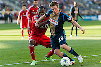 Antoine Hoppenot (29) of the Philadelphia Union is defended by Gale Agbossoumonde (6) of Toronto FC. Toronto FC and the Philadelphia Union played to a 1-1 tie during a Major League Soccer (MLS) match at PPL Park in Chester, PA, on April13, 2013.