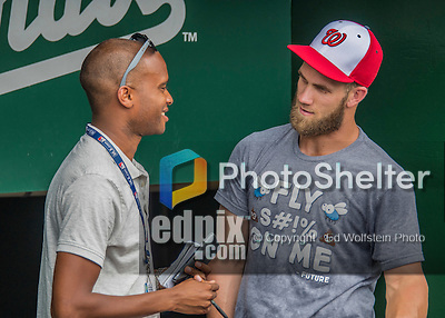 23 July 2016: Washington Nationals outfielder Bryce Harper chats with MLB.com Reporter Jamal Collier prior to a game against the San Diego Padres at Nationals Park in Washington, DC. The Nationals defeated the Padres 3-2 on a Stephen Drew pinch-hit, walk-off triple in the bottom of the 9th inning to tie their series at one game apiece. Mandatory Credit: Ed Wolfstein Photo *** RAW (NEF) Image File Available ***