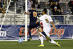 12 December 2014: UMBC's Marquez Fernandez (5) knocks Virginia's Jake Rozhansky (17) off the ball in the penalty area. The University of Virginia Cavaliers played the University of Maryland Baltimore County Retrievers at WakeMed Stadium in Cary, North Carolina in a 2014 NCAA Division I Men's College Cup semifinal match.