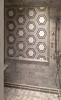 This custom shower features Pembroke, a handmade mosaic shown in honed Nero Marquina, Bardiglio, Thassos and Carrara, a part of the Silk Road Collection by Sara Baldwin for New Ravenna.<br />