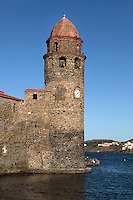 Bell tower, Eglise Notre Dame des Anges, Collioure, France. The bell tower was converted from a medieval lighthouse and the Mediterranean Gothic style nave was built in 1684. The dome was added to the bell tower in 1810. Picasso, Matisse, Derain, Dufy, Chagall, Marquet, and many others immortalized the small Catalan harbour in their works. Picture by Manuel Cohen.