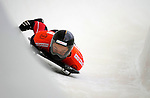 14 December 2007: Masaru Inada, racing for Japan, exits the last turn and heads for the finish line at the FIBT World Cup Skeleton Competition at the Olympic Sports Complex on Mount Van Hovenberg, at Lake Placid, New York, USA. ..Mandatory Photo Credit: Ed Wolfstein Photo