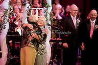 Jane Lighty and Pete-e Petersen, facing camera, and Donald Jenny and Neil Hoyt get married by Judge Anne Levinson (ret.) at Benaroya Hall during intermission of the Seattle Mens' Chorus on December 9, 2012. Jane Lighty and Pete-e Petersen are considered the matriarchs of the Washington same-sex-marriage movement.