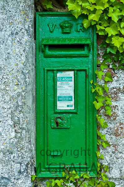 Green postbox with initials VR, Victoria Regina, from reign of Queen Victoria, at Fethard-on-Sea, Co. Wexford, Ireland