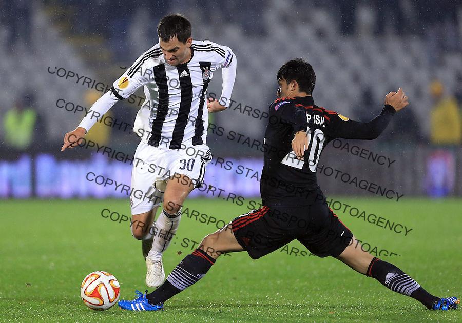 Fudbal Football Soocer<br /> UEFA Europe League <br /> Partizan v Besiktas<br /> Branko Ilic (L) and Necip Uysal<br /> Beograd, 23.09.2014.<br /> foto: Srdjan Stevanovic/Starsportphoto&copy;