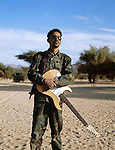 Bibi Ahmed, 29 years old, joined the MNJ in February 2008. Since then, he is guitar player in the Touareg music group, newly settled by the rebels in order to spread their message all over the Sahel. In the 90?s already, as the first rebellion took place, such a group was created and became famous up to Europe. Northern Niger. March 2008.