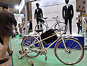 December 16, 2011, Tokyo, Japan - Models of Super Commuter concept bike - a frameset thats available in a variety of configurations - are shown at Eco-Products 2011 opened in Tokyo on Friday, December 16, 2011...The exhibition was one of the largest environmental exhibitions in Japan, showcasing innovative technologies and solutions for business. The three-day trade show drew more than 180,000 business people and consumers interested in environmental issues. (Photo by Natsuki Sakai/AFLO) [3615] -mis-