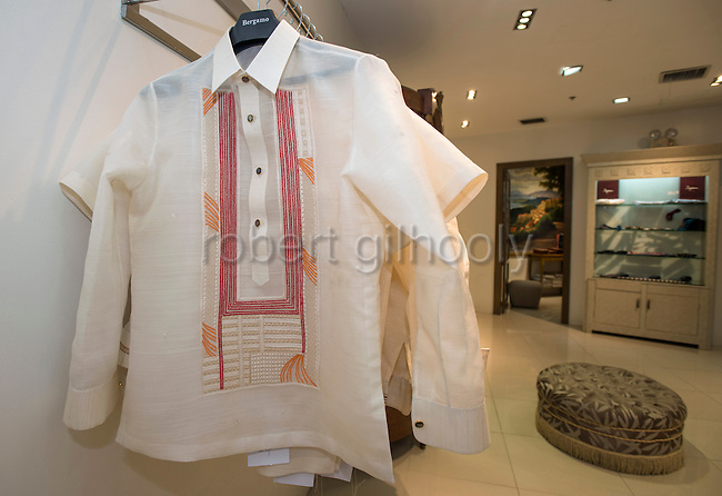 Photo shows Barong Tagalog shirts on sale inside Bergamo store in the financial district of Manila, the Philippines on Feb. 11, 2015. Barong have been a part of Philippine culture for over five centuries, but places like Bergamo have given a contemporary flare to the shirts.  ROB GILHOOLY PHOTO