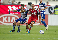FC Dallas midfielder Ricardo Villar #11and Toronto FC defender Mikael Yourassowsky #19 in action during an MLS game between the FC Dallas and the Toronto FC at BMO Field in Toronto on July 20, 2011.
