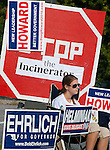 Photo by Phil Grout..Murphy for Governor supporter Abi Fuller takes the elctioneering in her stride.sitting in a lawn chair, surrounded by political posters in front of the Carrolltowne.Elementary School polling place.