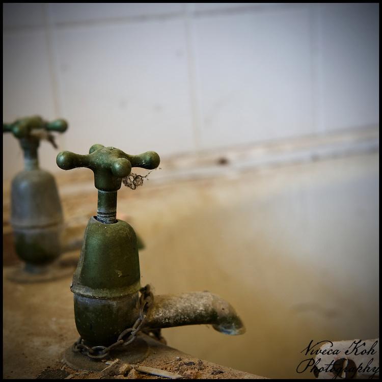 Cobwebby bath taps