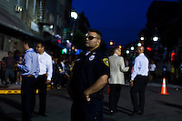 A NJ police officer stand guard during the National Night Out festivities in Union City, New Jersey, Aug 6, 2013. Photo by Eduardo Munoz Alvarez / VIEWpress.