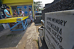 """In the capital of the Philippines, youth play a game in the Manila North Cemetery. Hundreds of poor families live here, dwelling in and between the tombs and mausoleums of the city's wealthy. They are often discriminated against, and many of their children don't go to school because they're too hungry to study and they're often called """"vampires"""" by their classmates. With support from United Methodist Women, KKFI provides classroom education and meals to kids from the cemetery at a nearby United Methodist Church."""