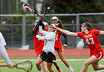 CHESHIRE, CT-042517JS17- Cheshire's Vicki Palmer (7) fires a shot on goal to score, despite being defended by Branford's Autumn McHenry (43), in the first half of their game Tuesday Cheshire High School. <br /> Jim Shannon Republican-American