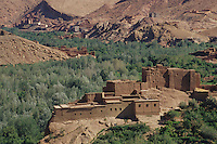 Dades Gorge, Morocco - Traditional Houses in the Foreground, Concrete Constructions in Background.  Vegetation stays close to the watercourse in the valley.