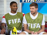 Steven Gerrard and Glen Johnson of England start on the bench