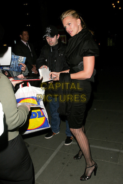 """NATASHA HENSTRIDGE.""""Gone With The Wind"""" press night party, Waldorf Hotel, Aldwych, London, England..April 22nd, 2008.full length black dress pattern tights collar fans signing autographs .CAP/AH.©Adam Houghton/Capital Pictures."""
