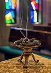 Incense burns in monastic chapel.