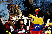 A father cheers with his daughter while Venezuela Immigrants supporters of Leopoldo Lopez and Henrrique Capriles take part in a protest against Venezuelas president Nicolas Maduro in Central park, New York. FEB 23, 2014. Photo by Eduardo Munoz Alvarez/VIEWpress