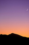 Crescent moon and evening light over the San Francisco Peaks from Wupatki National Monument, Arizona USA