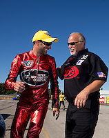 Sep 29, 2013; Madison, IL, USA; Rickie Smith (right) congratulates son NHRA pro stock motorcycle rider Matt Smith who celebrates after winning the Midwest Nationals at Gateway Motorsports Park. Mandatory Credit: Mark J. Rebilas-