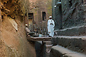 23/01/12. Lalibela, Ethiopia. Views from within the first set of rock-hewn churches, Lalibela. A church guard (left) and priest (right) outside one of the churches. Photo credit: Jane Hobson.