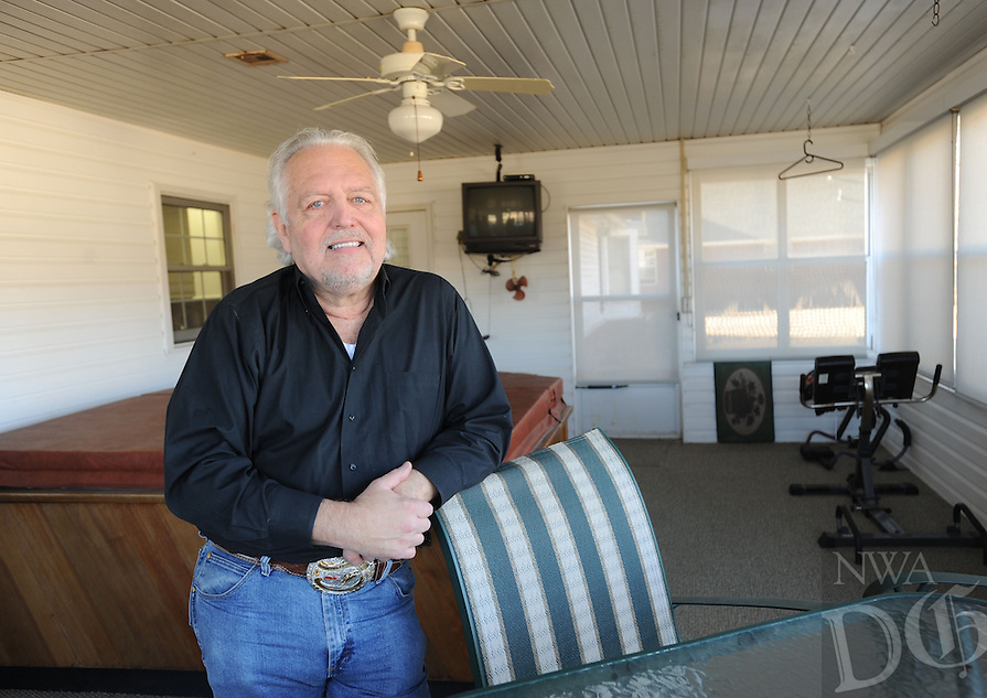 NWA Democrat-Gazette/ANDY SHUPE<br /> Rick Culver, executive director of the Rodeo of the Ozarks, enjoys spending time in his covered patio at his Springdale home that features a hot tub and television.