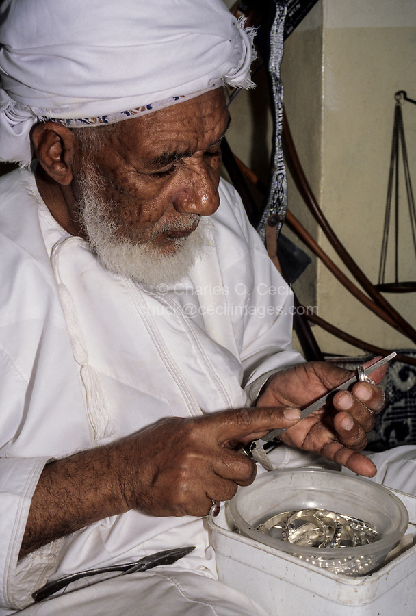 Rustaq, Oman.  Rashid al-Obeidani, Silversmith, in his Workshop, Filing a Silver Ring.