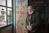 Portrait of Mimmo Cuticchio behind the entrance of his theatre.Ritratto di Mimmo Cuticchio