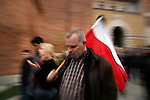 A man carries the Polish flag tied with a black ribbon as a sign of mourning. Thousands of Krakovians attended a mass at Wawel Castle Saturday evening to honor Polish President Lech Kaczynski. He and many of the country's top leaders were killed in a plane crash Saturday morning on route to the site of a Soviet massacre of Polish officers during World War II. . April 10, 2010