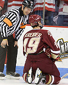 Tim Benedetto checks on Chris Kreider (BC - 19). - The visiting Boston College Eagles defeated the Boston University Terriers 3-2 to sweep their Hockey East series on Friday, January 21, 2011, at Agganis Arena in Boston, Massachusetts.