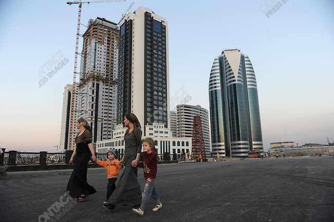 Mothers and children walked past the site of Grozny City, a new project of skyscrapers being constructed by a Turkish company that is due for completion in October 2011, in central Grozny, the Chechen capital. Huge amounts of Grozny have been completely rebuilt in the last few years and the city which was once brutally scarred by war now bears few traces of conflict. September 7, 2011