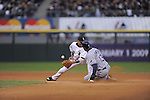 CHICAGO - October 6:  Orlando Cabrera of the Chicago White Sox can't handle the throw as Carl Crawford steals 2nd base during the 6th inning of the game against the Tampa Bay Rays at U.S. Cellular Field in Chicago, Illinois on October 6, 2008.  The Rays defeated the White Sox 6-2 to advance to the ALCS.  (Photo by Ron Vesely)