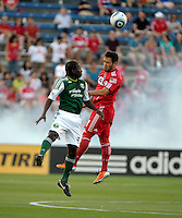Chicago midfielder Daniel Paladini (11) heads the ball in front of Portland midfielder Diego Chara (21).  The Portland Timbers defeated the Chicago Fire 1-0 at Toyota Park in Bridgeview, IL on July 16, 2011.