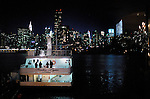 The Harbor Light, docked with a perfect view of the illuminated Manhattan skyline, prepares to ferry the wedding party on a cruise to the Statue of Liberty