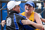20110418 - Boston, Mass. - Emily Nohner gives a hug to Tufts President's Marathon Challenge team coach Don Megerle at the finish of the 115th Boston Marathon on April 18, 2011.  (Kelvin Ma/Tufts University)