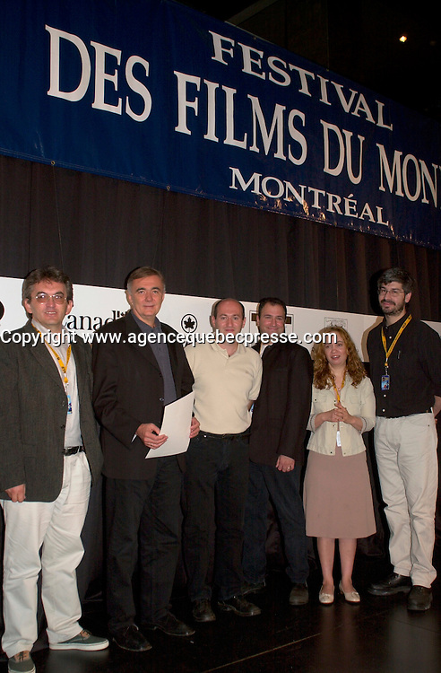 Sept 7,  2003, Montreal, Quebec, Canada<br /> <br /> Serbian-Montenegro film maker Dusan Kovacevic (R)<br /> and translator (L) pose with the FIPRESCI Jury after receiving an the FIPRESCI AWard for his movie THE PROFESSIONAL (PROFESIONALAC) <br /> <br /> <br /> The Festival runs from August 27th to september 7th, 2003<br /> <br /> <br /> Mandatory Credit: Photo by Pierre Roussel- Images Distribution. (&copy;) Copyright 2003 by Pierre Roussel <br /> <br /> All Photos are on www.photoreflect.com, filed by date and events. For private and media sales