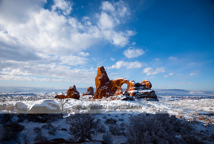 Turret Arch looms in the distance.  Fantastic rock formations and arches sculpted over thousands of years by wind, rain, and other forces of erosion dot the winter landscape of the Windows Section of Arches National Park in southern Utah.