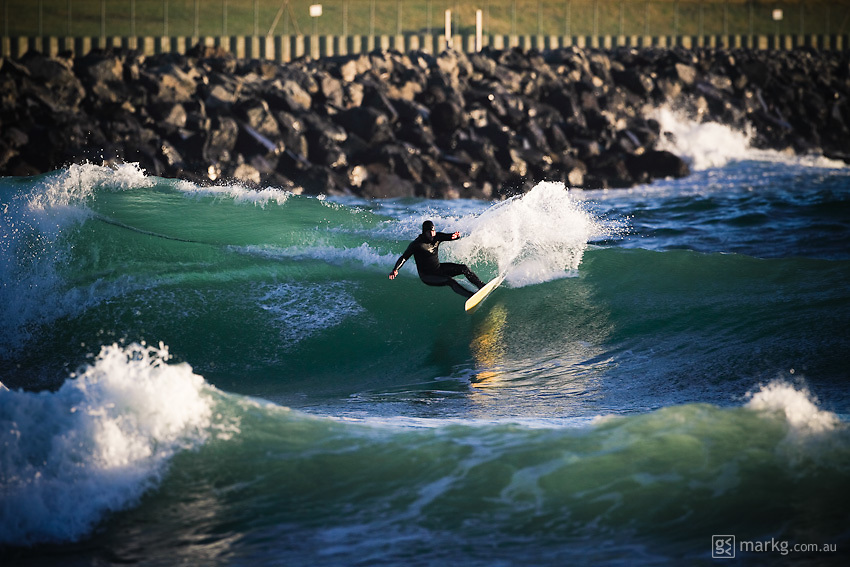 A late afternoon surf in slightly ruffled conditions at Lyall Bay, Wellington, New Zealand