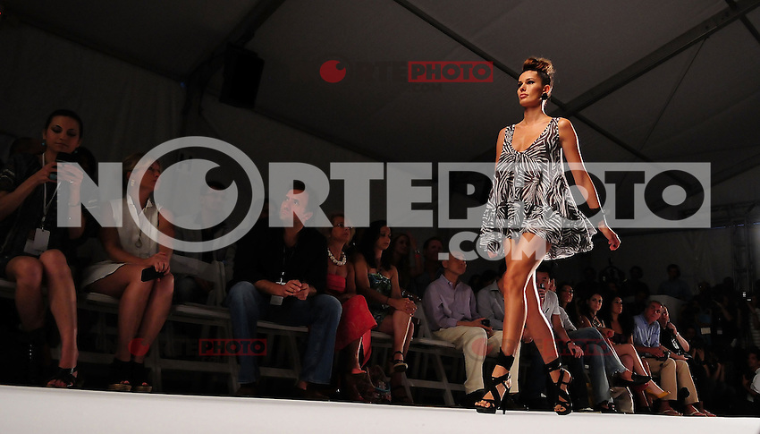 MIAMI BEACH, FL - JULY 15: A model walks the runway at the White Sands Australia show during Mercedes-Benz Fashion Week Swim 2012 at The Raleigh on July 15, 2011 in Miami Beach, Florida. (photo by: MPI10/MediaPunch Inc.)