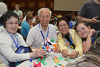 OrigamiUSA 2014 attendees from Japan enjoy folding paper between taking and teaching classes