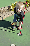 JOSEPH BURKE, 2 1/2, 11, from Valley Stream, plays miniature golf at Crow's Nest Mini Golf at the Nautical Mile in Freeport, on September 6, 2013